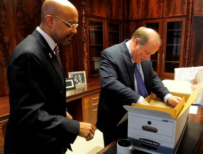 "Butch Hollowell, new house ""N,"" helps ""mayor"" Mike Duggan move into his office."