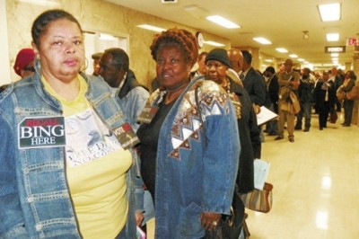 Sandra Hines, Lila Cabill, dozens line up in hallway outside Council chambers Nov. 20, 2012 after Pugh refused to move meeting to auditorium.