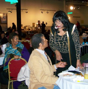 Gwen Mingo, formerly chair of Brush Park CDC, talks with Jimmy Cole at Call 'Em 'Out dinner Feb. 25, 2012.