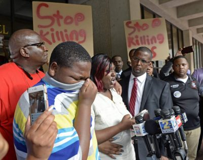 Alton Sterling's son Cameron Sterling, 15, weeps as his mother Quinyetta McMillan speaks at press conference July 6, 2016.