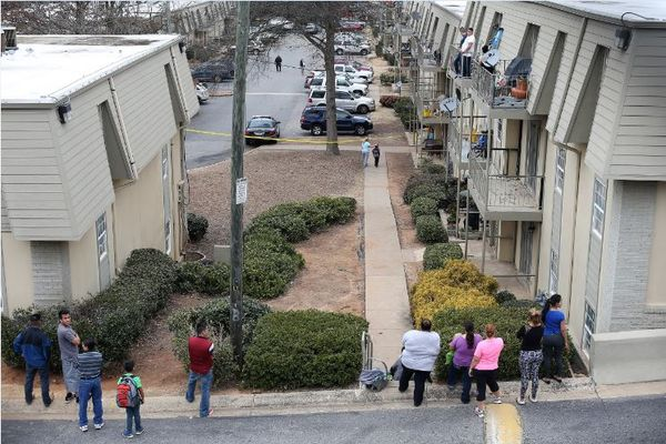 Onlookers gather at Chamblee Apartments where Hill died.