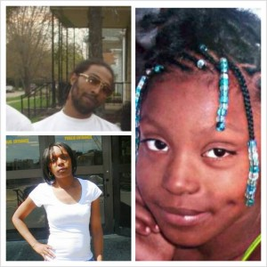 Dominika Jones, mother of Aiyana Jones, with Aiyana's father Charles Jones at upper left. Aiyana was murdered by Detroit police May 16, 2010.