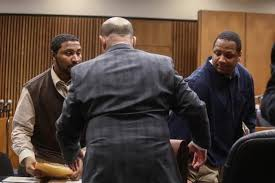 Charles Jones (l) and Chauncey Owens (r) during trial; Jones' attorney Leon Weiss with back to camera.