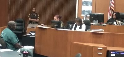 Charles Lewis (l) asks Judge Qiana Lillard (r) to follow the law.