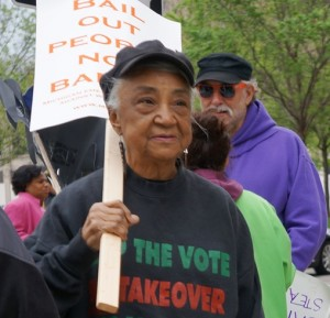 Elder Helen Moore of the Keep the Vote No Takeover Coalition protested the devastation of Detroit Public Schools through bank debt that has drained district of per-pupil funding.