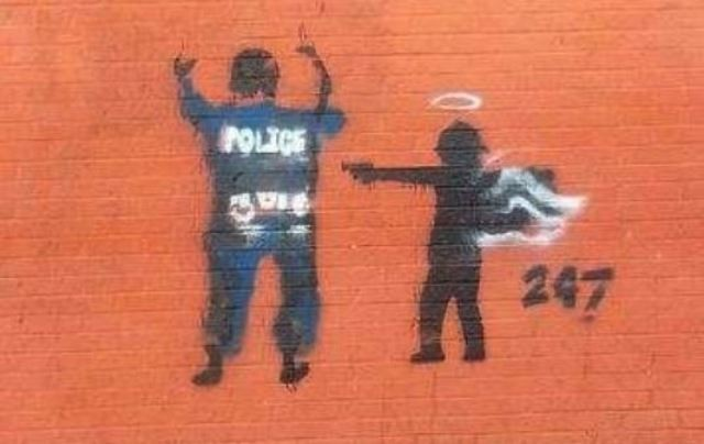 Two Black teens face up to ten years in prison for painting mural likely depicting a child angel arresting the cop who killed her.
