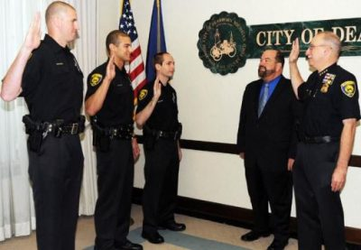 Mayor Jack O'Reilly with Dearborn Police Chief Ronald Haddad swear in new recruits (l to r) Bryan Fox, Christopher Hampton, and Andrew Galuska. July 24, 2010/Dearborn Press and Guide