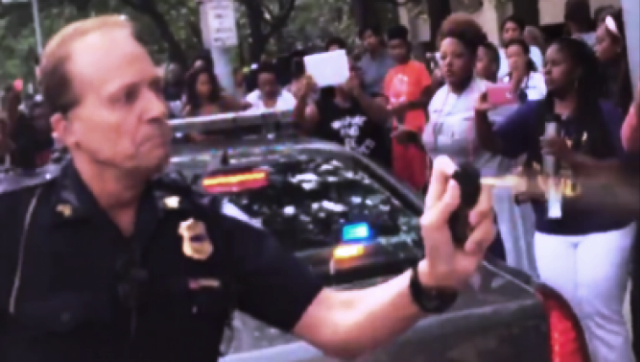 Cleveland cop pepper sprays attendees at Black Lives Matter convention.