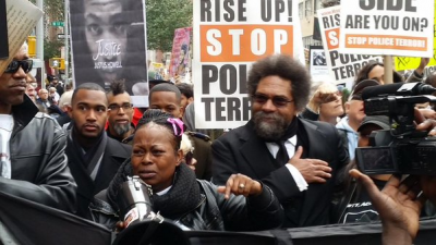 Cornel West marches with families of police terror victims.