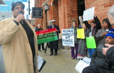 Cornell Squires speaks at protest outside Wojtowicz office March 31, 2015.