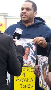 Squires at protest on anniversary of Detroit police killing of Aiyana Jones, 7, in 2010.