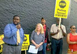 "SCLC leader Cortly ""C.D."" Witherspoon speaks during earlier protest against police brutality."