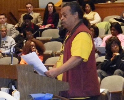 DAREA Pres. William Davis begins presentation to City Council; dozens of members took turns reading it to the end.