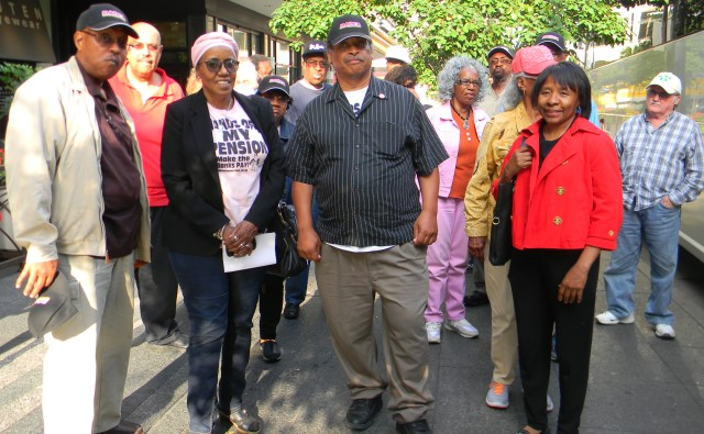 "DAREA members disembark from bus in Cincinnati June 15, 2016. In center is DAREA President Bill Davis, to his right is DAREA VP Cecily McClellan. At far right is retiree Ezza Brandon. They were allowed to wear their ""Hands off my Pension"" T-shirts in the 6th Circuit courtroom as arguments on bankruptcy appeals were heard. The bus was full, with over 40 retirees."