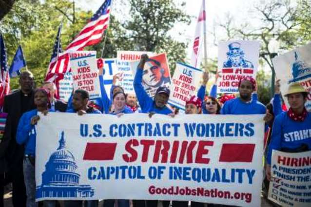 DC service workers strike during Papal visit.