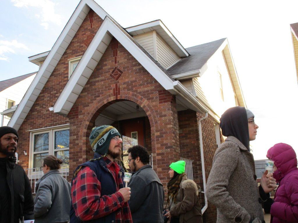 Detroit People's Platform holds candlelight vigil at Treasurer Wojtowicz' home March 30.