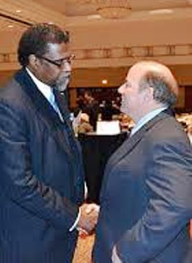 Darnell Earley, then Flint EM, with Detroit Mayor Mike Duggan during Michigan Municipal League convention, 2014.