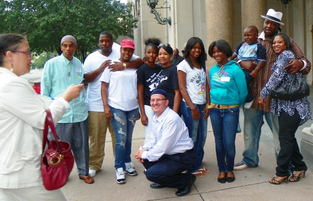Davontae Sanford family and supporters after appeals court hearing August 6 Mother Taminko Sanford-Tilmon and stepfather Jermaine Tilmon at right. Detroit News reporter takes their photo at left.