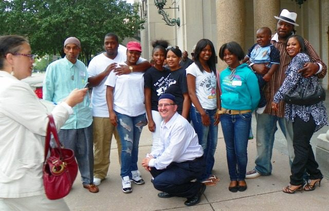 Davontae Sanford family and supporters after appeals court hearing August 6, 2013. Mother Taminko Sanford Tilmon and stepfather Jermaine Tilmon at right; paralegal Roberto Guzman in front; Detroit News reporter Oralandar Brand Williams at left taking photos.jpg