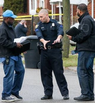 Is this the Dearborn cop who killed Matthews? At scene of shooting, he appears to be explaining action with his hands.