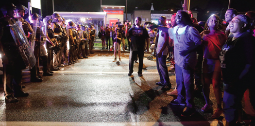 Protesters face off against police on West Florissant, where Michael Brown died. FC photo