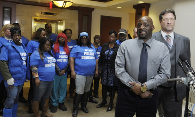 Floyd Dent appears with attorney Gregory Rohl and supporters at press conference after beating.