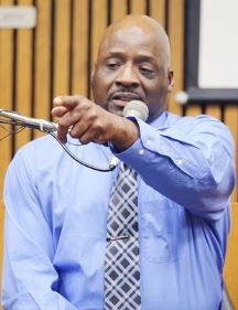 "Floyd Dent points out ""Robocop"" Melendez in court during trial."