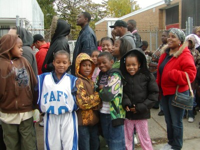 Detroit children wait for free coats given away by the Moorish Science Temple of America.