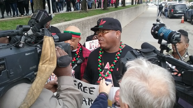 Doc X and other supporters of Charles Lewis and Michigan juvenile lifers apeak to media before hearing October 11. Photo: Cornell Squires