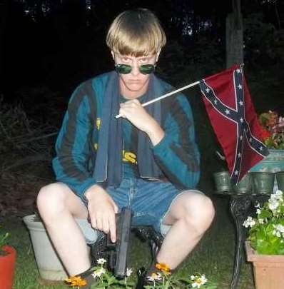 Dylan Roof in photo from racist website.