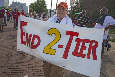 Detroit, Michigan - Members of the United Auto Workers participate in the Labor Day parade days before their union contracts with GM, Ford, and Fiat Chrysler expire. Retired Ford worker Ron Lare wants to end the two-tier pay system the union accepted in 2007.