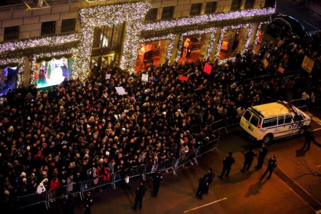 Protesters flood Rockefeller Center during Xmas tree lighting.