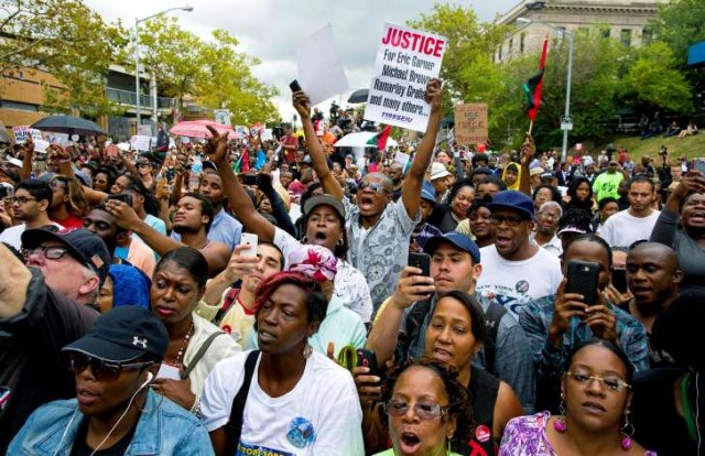 Demonstrators flooded streets in New York City, Oakland, CA and other places across the country after grand jury refused to indict NYPD killer cop in Eric Garner murder.
