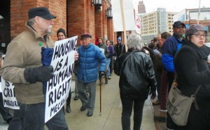 Activist pastor Bill Wylie-Kellerman (left) takes part in March 31 protest.