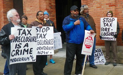 Protesters swamp sidewalks outside Treasurer's office March 31.