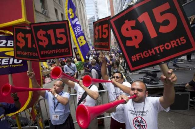 Fast food workers rally in New York City; they have just won their demand throughout the state.