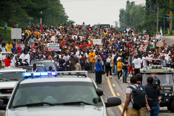 Crowds mass in streets of Ferguson to remember Michael Brown and all victims of police, 706 so far in 2015 alone.