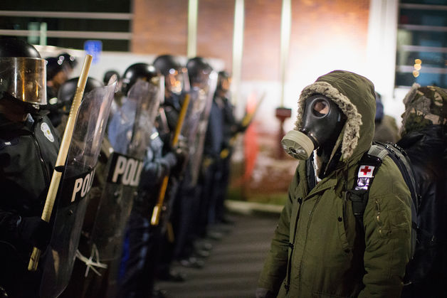 Ferguson cops and protesters outside police station Nov. 22, 2014.