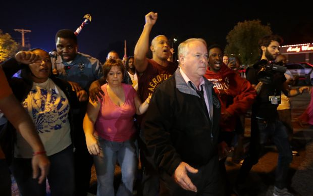 Ferguson police chief Thomas Jackson just before police attacked protesters, who were protecting him.