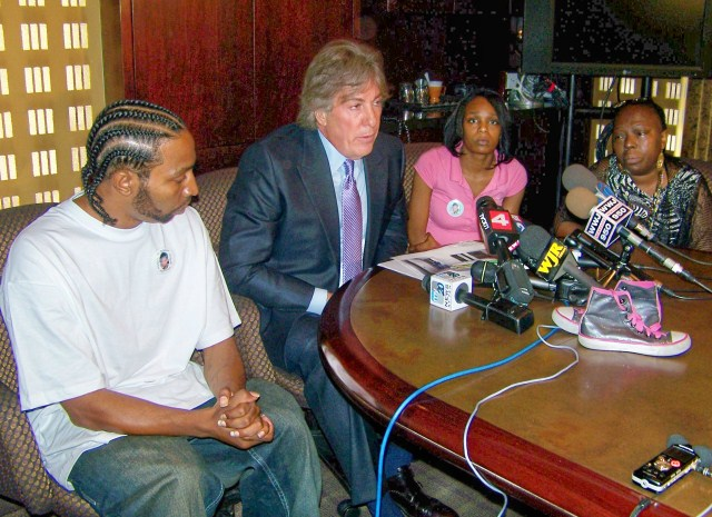 Atty. Geoffrey Fieger holds press conference May 27, 2010; l to r Aiyana's father Charles Jones, mother Dominika Stanley-Jones, grandmother Mertilla Jones (weeping), Both mother and grandmother have lost significant amounts of weight and experienced PTSD since that time,