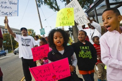 Flint kids join protest against poisoning of their city's water.