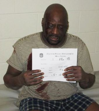 Floyd Dent, bloodied and seriously injured, in police cell. No medical attention was given for hours.