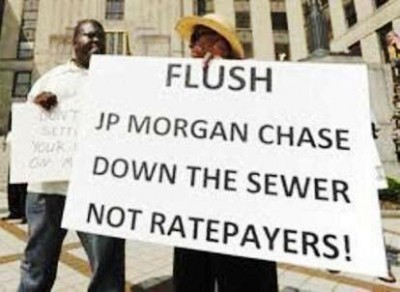 "Demonstration in Birmingham, Ala. against Jefferson County bankruptcy plan. JP Morgan Chase was involved in the corrupt ""sewer warrants"" that caused the majority of the county's debt."