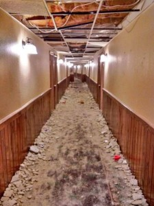 TreeTops resort hallway after frat boys trashed it in January,