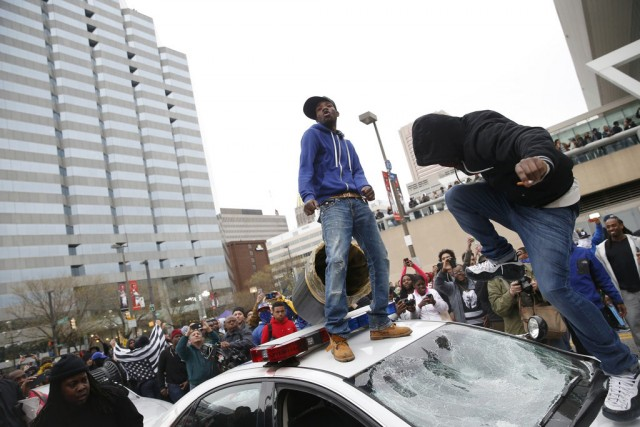 Freddie Gray protesters attacked police cars. Photo: Shannon Stapleton/Reuters.