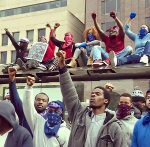 Protesters against death of Freddie Gray take to roofs. Despite allegations that people from outside Baltimore controlled the protests, photos like these showed differently. Protesters were prepared for attacks by police. Thirty-four were arrested.