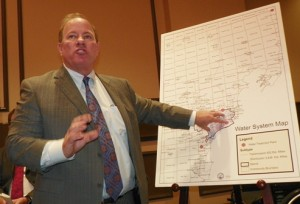 """Mayor"" Mike Duggan shows what will be left of DWSD on map of six counties to be taken over by GLWA, during press conference."