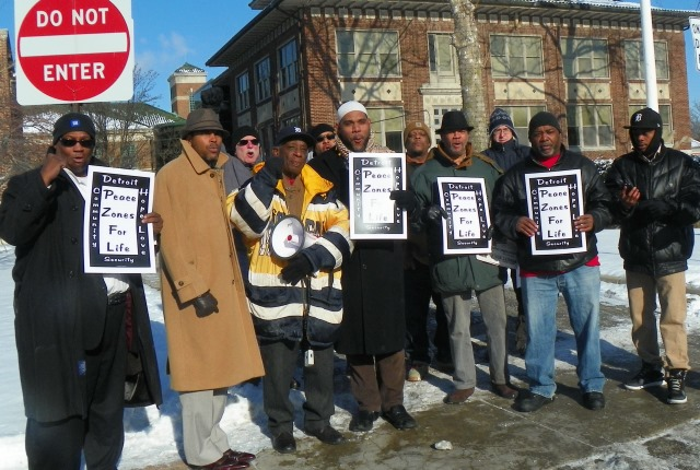 Ron Scott (with bullhorn) of Detroit Coalition Against Police Brutality, Inc. and others protest police beating of Andrew Jackson, Jr. outside Grosse Pointe Park police HQ Jan. 14, 2015.