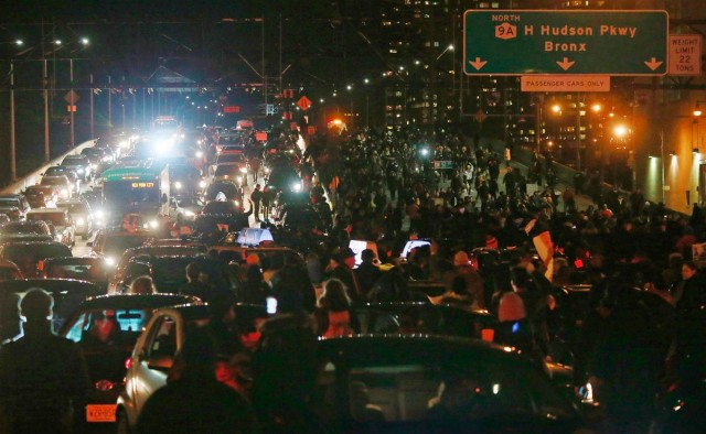 NYC protesters block traffic on Brooklyn Bridge.