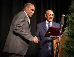 Rev. Pinkney reads award to supporter Danny Glover at dinner in 2012.